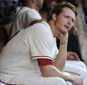 Photo - St. Louis Cardinals starting pitcher Shelby Miller watches the baseball game against the Washington Nationals in the fourth inning Saturday, June 14, 2014, at Busch Stadium in St. Louis. (AP Photo/Bill Boyce)