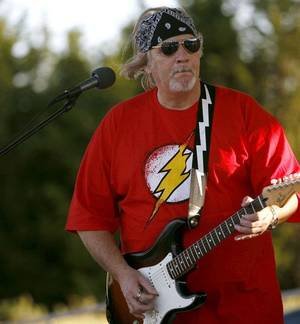 Photo - Bud Kurtz, with the band Straight Shooter, performs at the Mitch Park Amphitheater. PHOTO BY JOHN CLANTON, THE OKLAHOMAN. <strong>JOHN CLANTON - THE OKLAHOMAN</strong>