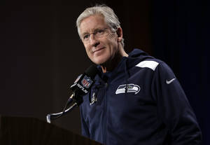 Photo - Seattle Seahawks head coach Pete Carroll listens to a question during a news conference Monday, Jan. 27, 2014, in Jersey City, N.J. The Seahawks and the Denver Broncos are scheduled to play in the Super Bowl XLVIII football game Sunday, Feb. 2, 2014. (AP Photo/Jeff Roberson)