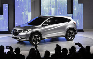 photo - The Honda Urban SUV Concept is shown at media previews for the North American International Auto Show in Detroit, Monday, Jan. 14, 2013.  (AP Photo/Paul Sancya)