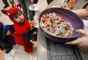 Photo - Miguel Delorea, 3, joins other children in costumes to trick or treat at Sooner Mall in Norman on Oct. 31, 2008.   BY STEVE SISNEY, THE OKLAHOMAN <strong>STEVE SISNEY</strong>