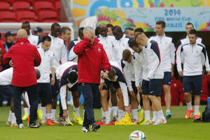 Photo - France's soccer team head coach Didier Deschamps gestures during an official training at the Estadio Beira-Rio in Porto Alegre, Brazil, Saturday, June 14, 2014. France will play in group E of the World Cup. (AP Photo/David Vincent)