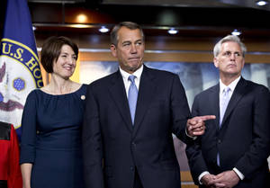 photo -   Speaker of the House John Boehner, R-Ohio, center, speaks to reporters after the House Republicans voted for their leadership for the next session of Congress, at the Capitol in Washington, Wednesday, Nov. 14, 2012. House Republicans elevated Rep. Cathy McMorris Rodgers, R-Wash., left, to lead the Republican Conference, with House Majority Whip Kevin McCarthy, R-Calif., right, returning in his role. House Majority Leader Eric Cantor, R-Va., and Boehner were both reelected to their leadership posts. (AP Photo/J. Scott Applewhite)