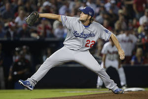 Photo - Los Angeles Dodgers starting pitcher Clayton Kershaw works in the second inning against the Atlanta Braves during Game 1 of the National League Division Series, Thursday, Oct. 3, 2013, in Atlanta. (AP Photo/John Bazemore)
