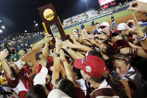 Photo - The Alabama Crimson Tide celebrates with the champioship trophy after winning Game 3 of the Women's College World Series softball championship between OU and Alabama at ASA Hall of Fame Stadium in Oklahoma City, Wednesday, June 6, 2012. Alabama won the third game, 5-4. Photo by Nate Billings, The Oklahoman