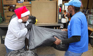 photo - James Oliver works with Mark Jarrett to load a truck at an EARC Thrift Store on 100 E Third St. in Edmond. Photos by David McDaniel, The Oklahoman