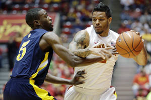 Photo -   Iowa State guard Chris Babb, right, drives past North Carolina A&T guard Jean Louisme during the first half of an NCAA college basketball game, Tuesday, Nov. 20, 2012, in Ames, Iowa. (AP Photo/Charlie Neibergall)
