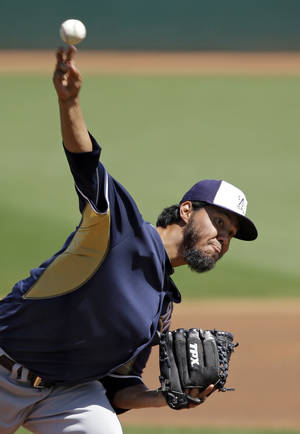 Photo - Milwaukee Brewers starting pitcher Yovani Gallardo delivers against the Cleveland Indians in the first inning of a spring exhibition baseball game Wednesday, March 26, 2014, in Goodyear, Ariz. (AP Photo/Mark Duncan)