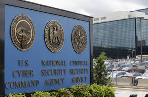Photo - FILE - This June 6, 2013, file photo shows the sign outside the National Security Agency campus in Fort Meade, Md. A presidential advisory panel has recommended dozens of changes to the government's surveillance programs, including stripping the NSA of its ability to store Americans' telephone records and requiring a court to sign off on the individual searches of phone and Internet data. (AP Photo/Patrick Semansky, File)