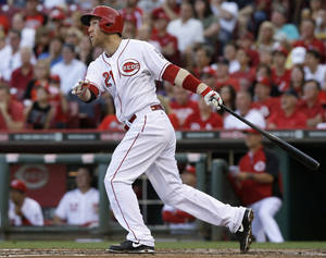 Photo - Cincinnati Reds' Todd Frazier follows through on a three-run home run off St. Louis Cardinals starting pitcher Shelby Miller in the third inning of a baseball game, Friday, May 23, 2014, in Cincinnati. (AP Photo/Al Behrman)