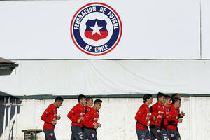 Photo - Chile's soccer players warm up for a training session in Santiago, Chile, Wednesday, May 28, 2014. Chile will play a friendly match with Egypt in Santiago on Friday prior to competing at the World Cup in Brazil in June.  (AP Photo/Luis Hidalgo)