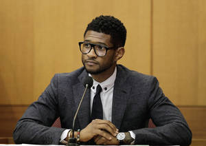 Photo -   FILE - In this May 22, 2012 file photo, hip-hop artist Usher Raymond takes the witness stand in court in a legal battle with his ex-wife in a custody fight involving their two sons, in Atlanta. Fulton County Court Clerk's office spokeswoman Cherrise Boone says a judge ruled Friday, Aug. 24, 2012 that the 33-year-old singer will have primary physical custody of Usher Raymond V and Naviyd Ely Raymond. (AP Photo/David Goldman, File)
