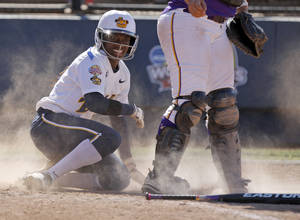 Photo - LSU's Jamia Reid looks up after scoring against California in the sixth inning of a  Women's College World Series game at ASA Hall of Fame Stadium in Oklahoma City, Thursday, May 31, 2012.  Photo by Bryan Terry, The Oklahoman