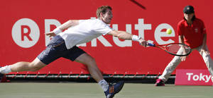 Photo -   Andy Murray of Britain returns the ball against Stanislas Wawrinka of Switzerland during their quarter-final match of Japan Open tennis championships in Tokyo, Friday, Oct. 5, 2012. (AP Photo/Koji Sasahara)