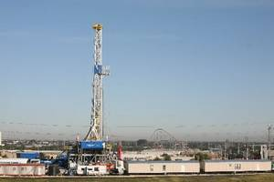 Photo - A rig drills for natural gas in the Barnett Shale field in the Dallas-Fort Worth area of Texas. PROVIDED BY CHESAPEAKE ENERGY CORP.