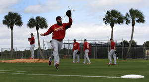 Photo - St. Louis Cardinals pitcher Jason Motte catches a ball as he takes part in a base covering drill during spring training baseball practice Thursday, Feb. 13, 2014, in Jupiter, Fla. (AP Photo/Jeff Roberson)