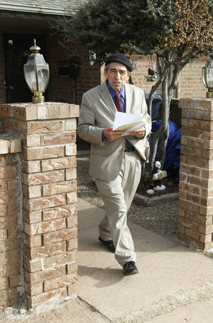 Photo - OKC School Board candidate Wilfredo Santos-Rivera, a former school board member who is challenging Ron Millican in the Feb. 11 election, goes campaigning door to door Jan. 30 in Oklahoma City. <strong>PAUL HELLSTERN - Oklahoman</strong>