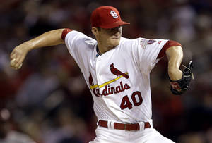 Photo -   St. Louis Cardinals starting pitcher Shelby Miller throws during the fourth inning of a baseball game against the Cincinnati Reds, Wednesday, Oct. 3, 2012, in St. Louis. (AP Photo/Jeff Roberson)