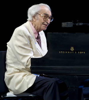 Photo - FILE - This July 4, 2009 file photo shows Jazz legend Dave Brubeck performing at the 30th edition of the Montreal International Jazz Festival  in Montreal. Brubeck, a pioneering jazz composer and pianist died Wednesday, Dec. 5, 2012 of heart failure, after being stricken while on his way to a cardiology appointment with his son. He would have turned 92 on Thursday. (AP Photo/The Canadian Press, Paul Chiasson)