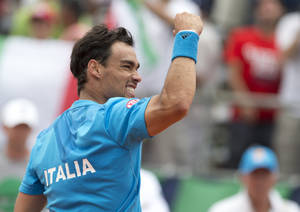 Photo - Italy's Fabio Fognini celebrates defeating Argentina's Juan Monaco 7-5, 6-2, 6-2 at their Davis Cup singles tennis match in Mar del Plata, Argentina, Friday, Jan. 31, 2014. (AP Photo/Eduardo Di Baia)
