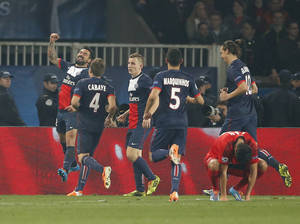 Photo - PSG's Ezequiel Lavezzi, left, celebrates his side's second goal with teammates during a Champions League last 16 second leg soccer match between Paris Saint Germain against Bayer Leverkusen at Parc des Princes stadium in Paris, Wednesday, March 12, 2014. (AP Photo/Michel Euler)