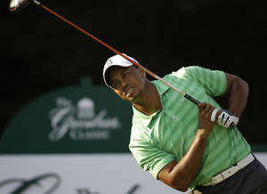 Photo -   Tiger Woods reacts to his tee shot on the 12th hole during the second round of the Greenbrier Classic PGA Golf tournament at the Greenbrier in White Sulphur Springs, W. Va., Friday, July 6, 2012. (AP Photo/Steve Helber)