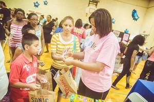 Photo - Clients and community members participate in a Back to School Bash sponsored by the Urban Leagues of Greater Oklahoma City.  Photo provided. <strong></strong>