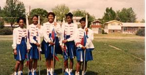 Photo - In this vintage photograph from the 1980s, members of the Millwood High School marching band flag corp. pose for a picture. Photo provided <strong></strong>