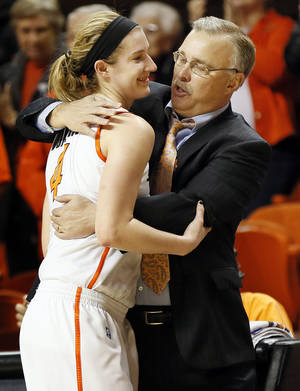 Photo - OSU head coach Jim Littell hugs Liz Donohoe (4) as she leaves the game late in the second half during the Bedlam women's college basketball game between Oklahoma State University and the University of Oklahoma at Gallagher-Iba Arena in Stillwater, Okla., Saturday, Feb. 23, 2013. OSU beat OU, 83-62. Photo by Nate Billings, The Oklahoman