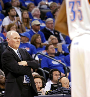 photo - Denver&#039;s Head Coach George Karl watches Oklahoma City&#039;s Kevin Durant during the first round NBA Playoff basketball game between the Thunder and the Nuggets at OKC Arena in downtown Oklahoma City on Wednesday, April 20, 2011. Photo by John Clanton, The Oklahoman
