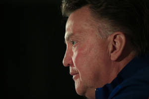 Photo - Louis van Gaal, coach of the Dutch national soccer team, listens to questions of journalists in a pre World Cup soccer tournament press conference, Tuesday, May 13, 2014, in Hoenderloo, east central Netherlands. Van Gaal said he would announce a preliminary 30-man squad later today. (AP Photo/Peter Dejong)