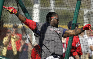 Photo - Boston Red Sox designated hitter David Ortiz takes batting practice during spring training baseball practice Tuesday, Feb. 18, 2014, in Fort Myers, Fla. (AP Photo/Steven Senne)