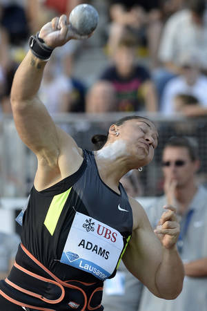 Photo -   Valerie Adams from New Zealand competes during the women's shot put event, at the Athletissima IAAF Diamond League athletics meeting in the Stade Olympique de la Pontaise in Lausanne, Switzerland, on Thursday, Aug. 23, 2012. (AP Photo/Keystone, Peter Schneider)
