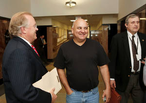 Photo - Sooner Tea Party co-founder Al Gerhart, center, smiles Tuesday as he leaves an Oklahoma County courtroom after prosecutors drop a contempt of court accusation against him. At left is his attorney, Mark Wilson. At right is Assistant Attorney General George Burnett. <strong>JIm Beckel - The Oklahoman</strong>