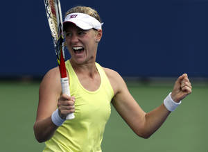 Photo - Alison Riske reacts after beating Petra Kvitova, of the Czech Republic, during the third round of the 2013 U.S. Open tennis tournament, Saturday, Aug. 31, 2013, in New York. (AP Photo/Julio Cortez)