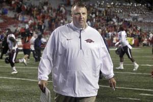 Photo - Arkansas coach Bret Bielema walks from the field after an NCAA college football game in Fayetteville, Ark., Saturday, Sept. 28, 2013. Texas A&M defeated Arkansas 45-33. (AP Photo/Danny Johnston)