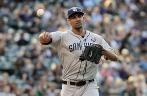 Photo - San Diego Padres starting pitcher Tyson Ross (38) throws to first base to put out Colorado Rockies' Justin Morneau in the first inning of a baseball game in Denver on Tuesday, July 8, 2014. (AP Photo/Joe Mahoney)
