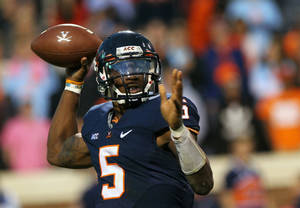 Photo - Virginia quarterback David Watford throws a pass against Duke second half of an NCAA college football game on Saturday, Oct. 19, 2013, in Charlottesville, Va. (AP Photo/The Daily Progress, Ryan M. Kelly)