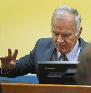 Photo -   Former Bosnian Serb military commander Gen. Ratko Mladic is seen at the start of his trial at the Yugoslav war crimes tribunal in The Hague, Netherlands, Wednesday May 16, 2012. Twenty years after the opening shots of the Bosnian War, Mladic has gone on trial on charges of genocide, crimes against humanity and war crimes, his appearance at the UN tribunal marks the end of a long wait for justice to survivors of the 1992-95 war that left some 100,000 people dead. (AP Photo/Toussaint Kluiters, Pool)