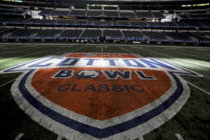 Photo - Sun shines on the midfield logo for the Cotton Bowl at Cowboys Stadium on Sunday, Dec. 30, 2012, in Arlington, Texas. Oklahoma and Texas A&M are scheduled to meet in the NCAA college football game Jan. 4. (AP Photo/LM Otero) ORG XMIT: TXMO101