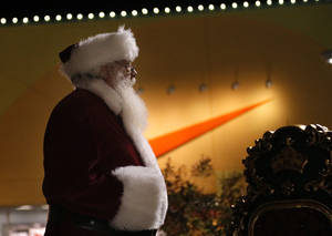 "Photo - Santa arrives for a tree lighting ceremony at The Outlet Shoppes at Oklahoma City. A Nike ""swoosh"" is seen in the background. <strong>SARAH PHIPPS - SARAH PHIPPS</strong>"