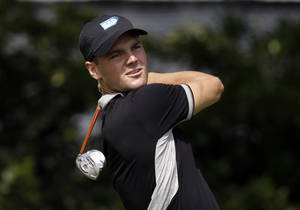 Photo - Martin Kaymer, of Germany, watches his shot off the fourth tee during the second round of the Byron Nelson Championship golf tournament, Friday, May 16, 2014, in Irving, Texas. (AP Photo/Tony Gutierrez)