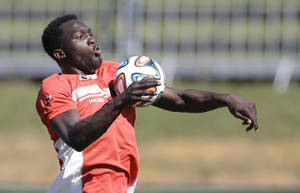 Photo - Belgium's Romelu Lukaku controls the ball during a team training session in Mogi Das Cruzes, Brazil, Friday, June 13, 2014. Belgium play in group H of the 2014 soccer World Cup. (AP Photo/Andrew Medichini)