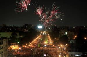 "Photo - Fireworks light the sky as opponents of Egypt's Islamist President Mohammed Morsi protest outside the presidential palace in Cairo, Egypt, Monday, July 1, 2013. Egypt's powerful military warned on Monday it will intervene if the Islamist president doesn't ""meet the people's demands,"" giving him and his opponents two days to reach an agreement in what it called a last chance. Hundreds of thousands of protesters massed for a second day calling on Mohammed Morsi to step down. (AP Photo/Khalil Hamra)"