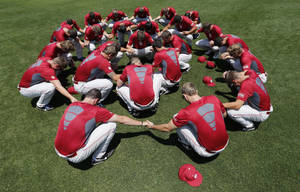 "Photo - University of Oklahoma (OU) Sooner Baseball team bow and recite the ""Lord's Prayer"" before practice on Tuesday, June 4, 2013 in Norman, Okla.  Photo by Steve Sisney, The Oklahoman"