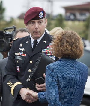 Photo - Brig. Gen. Jeffrey Sinclair shakes hands with his defense attorney Ellen C. Brotman outside the Fort Bragg, N.C., courthouse, Monday, March 17, 2014. Sinclair, who admitted to improper relationships with three subordinates, appeared to choke up as he told a judge that he'd failed the female captain who had leveled the most serious accusations against him. (AP Photo/The Fayetteville Observer, Johnny Horne)