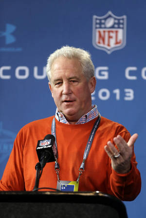 photo - Denver Broncos head coach John Fox answers a question during a news conference at the NFL football scouting combine in Indianapolis, Thursday, Feb. 21, 2013. (AP Photo/Michael Conroy)