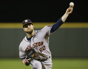 Photo - Houston Astros starting pitcher Dallas Keuchel throws during the fourth inning of a baseball game against the Seattle Mariners Monday, April 21, 2014, in Seattle. (AP Photo/Ted S. Warren)