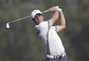 Photo - Rory McIlroy of Northern Ireland follows his ball on the 18th hole during the second round of the Dubai Desert Classic golf tournament in Dubai, United Arab Emirates, Friday Jan. 31, 2014. (AP Photo/Kamran Jebreili)