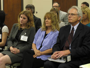 Photo -   Dr. Ann Kristin Neuhaus, center, sits between two of her attorneys, Kelly Kauffman, left, and Bob Eye, right, as the Kansas State Board of Healing Arts decides to revoke her medical license, Friday, June 22, 2012, in Topeka, Kan. The board board acted in response to allegations concerning referrals of young patients by Neuhaus to the late Dr. George Tiller for late-term abortions. (AP Photo/John Hanna)